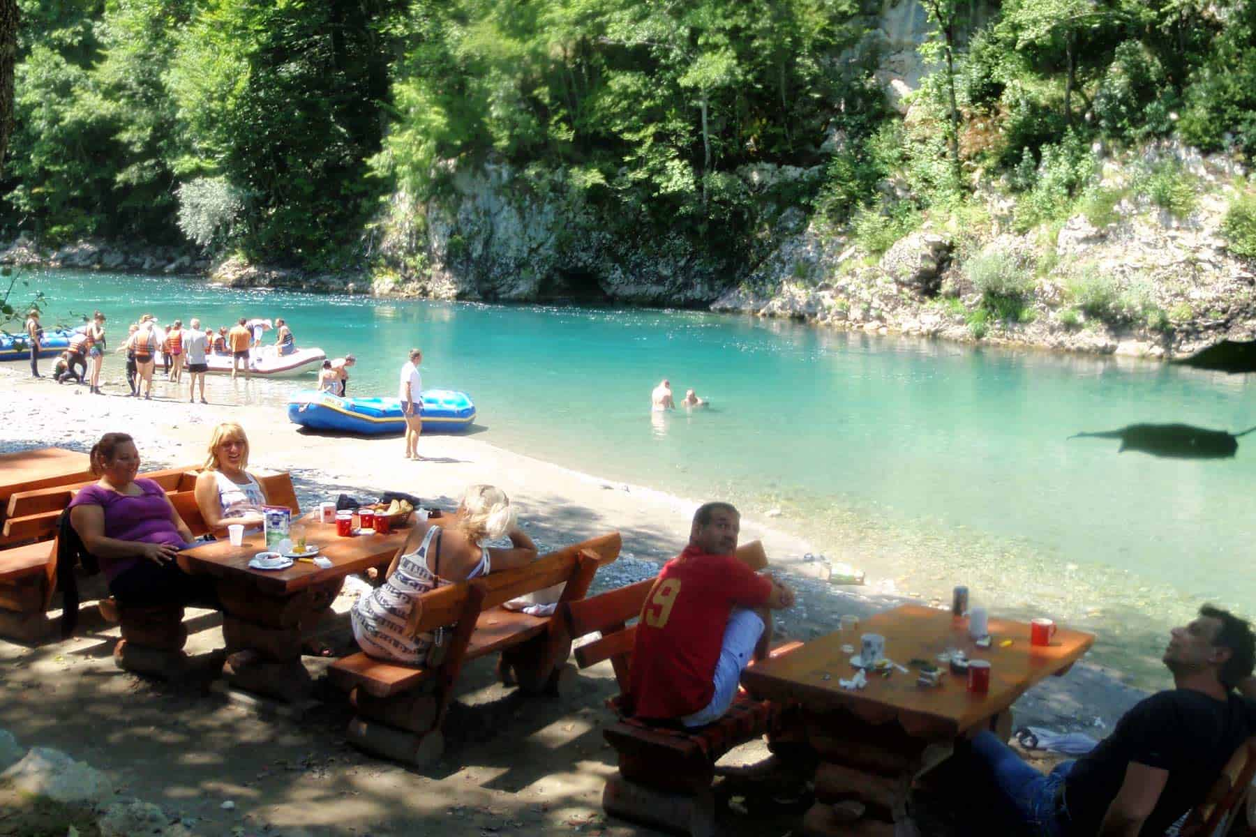 Emjoying a meal and drinks after rafting adventure