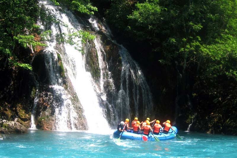 Pass by a beautiful waterfall during the rafting trip