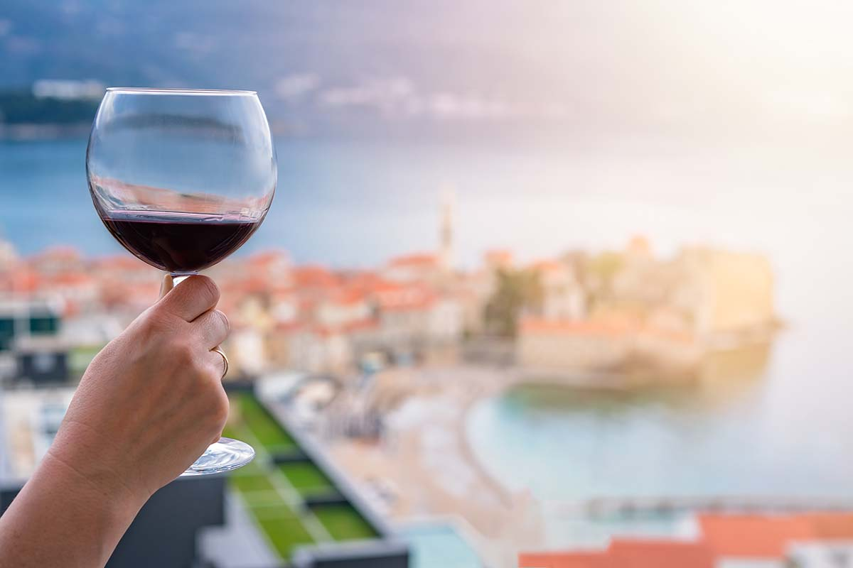 Drinking red wine in Budva